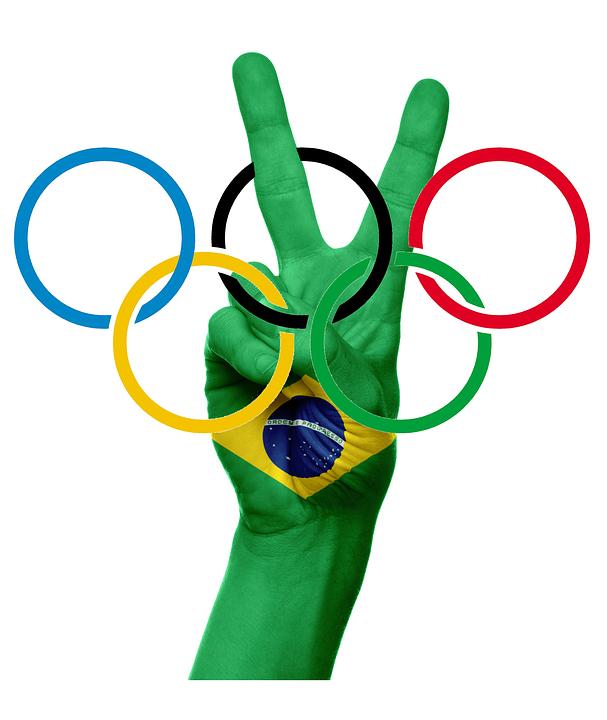 La antorcha olímpica iluminará la belleza de Brasil Олимпийские Кольца