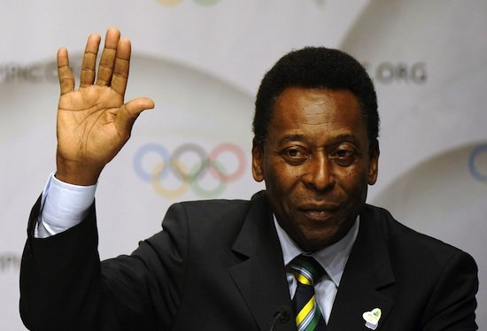 Brazilian former footballer  Pele waves on October 2, 2009 in Copenhagen after presenting Rio's bid for the 2016 Olympics. The International Olympic Committee (IOC) will vote on the destiny of the 2016 Summer Olympic Games on October 2, 2009 in Copenhagen after a final round battle. AFP PHOTO / FRANCK FIFE  (Photo credit should read FRANCK FIFE/AFP/Getty Images)